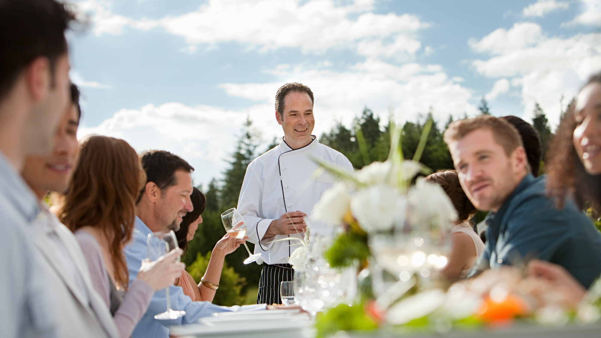 outdoor dinner party with chef