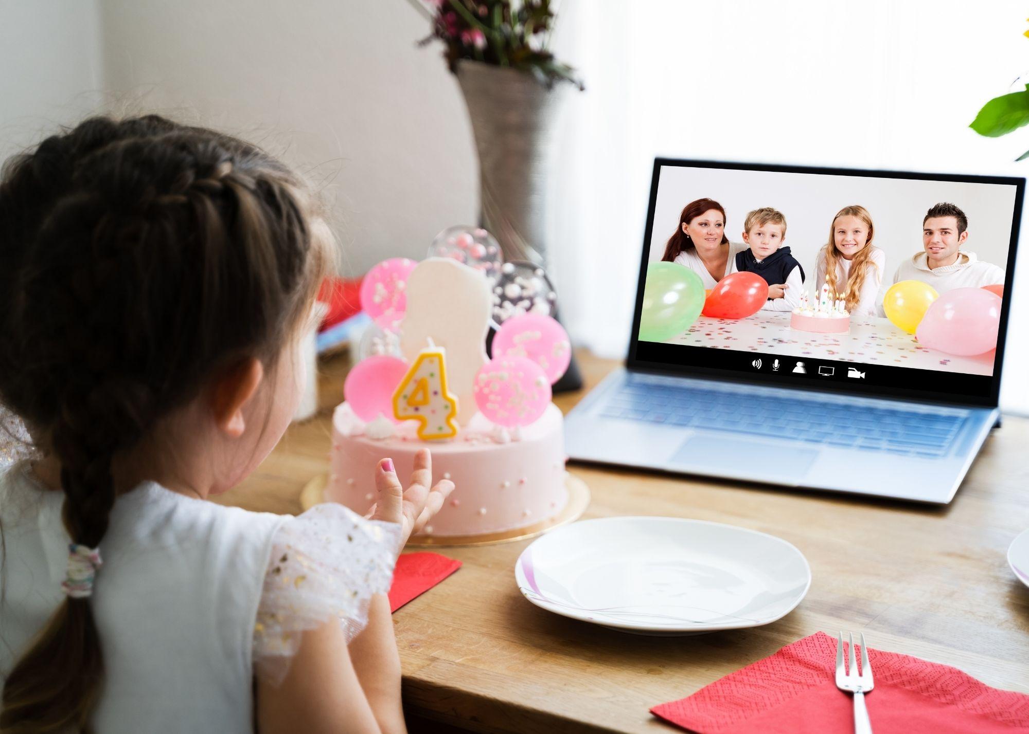 little girl watching birthday video