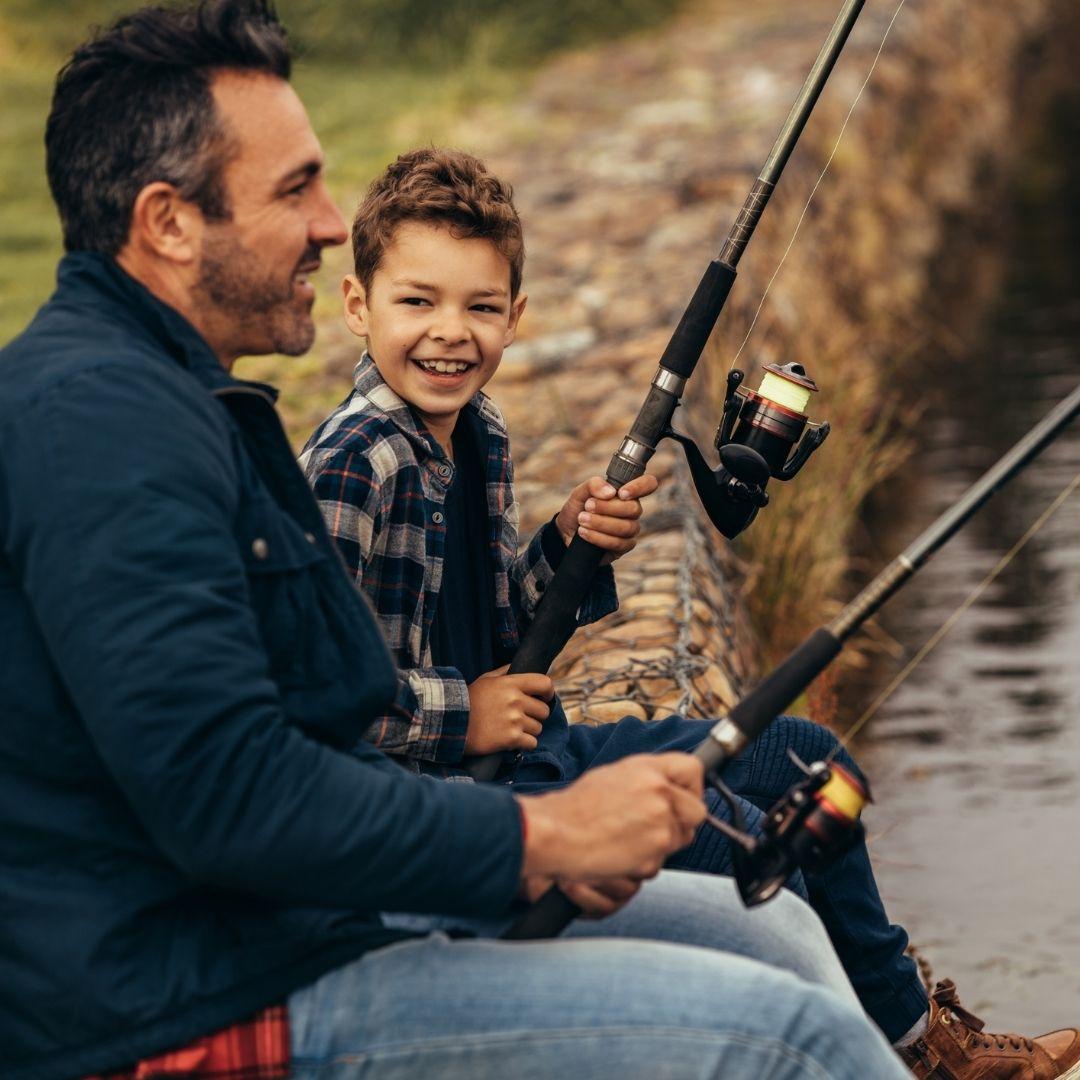 boy fishing with Dad