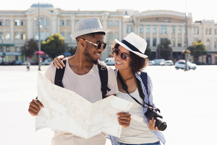 couple on vacation with map