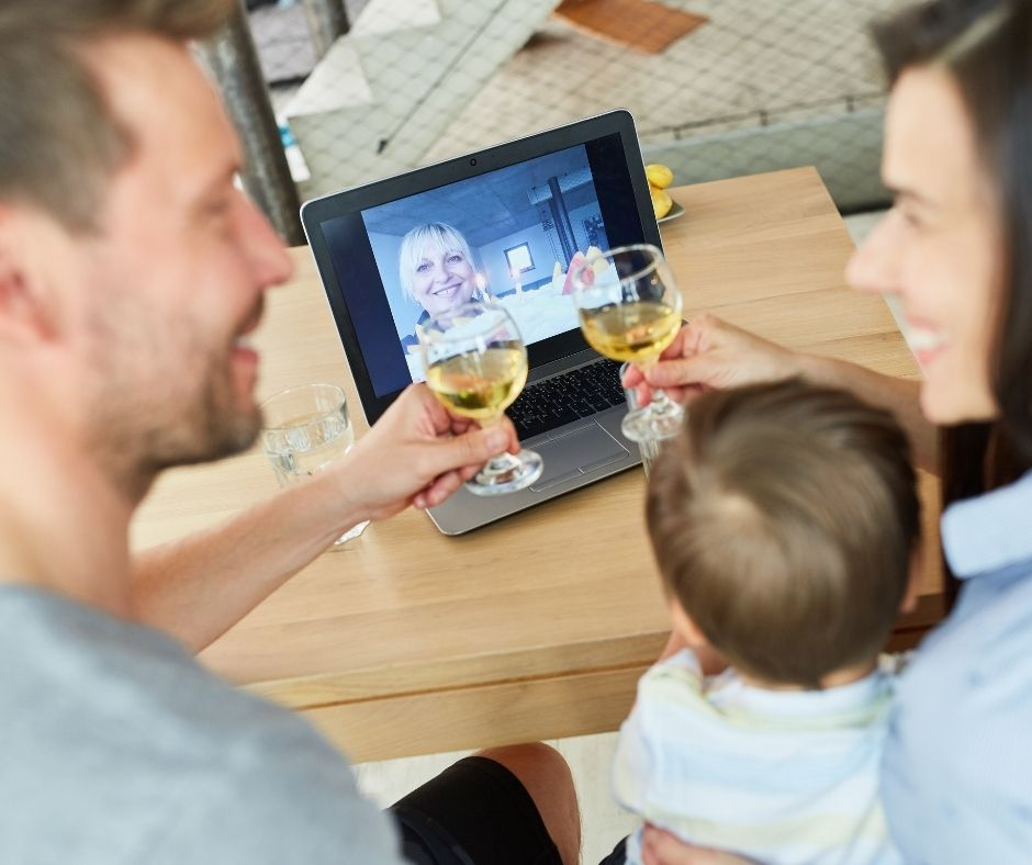 young couple celebrating anniversary watching video