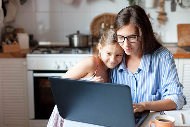 mother and daughter at laptop computer