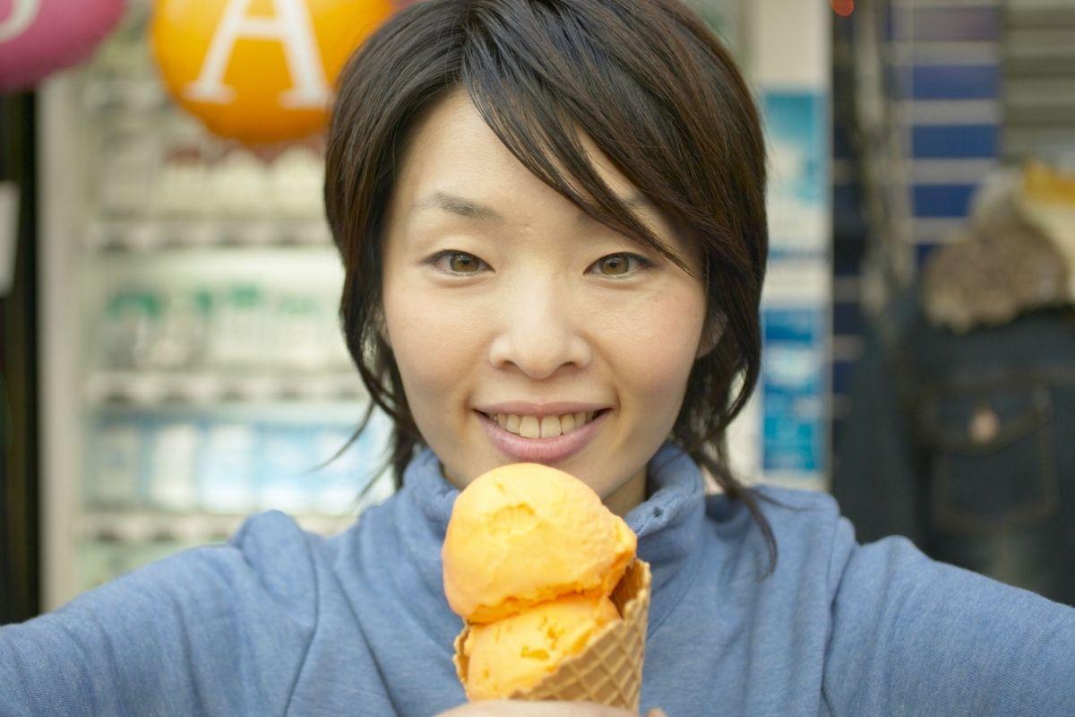 woman eating sherbert
