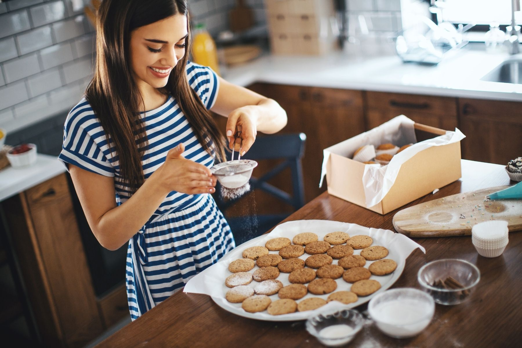 woman making and packing homemade cookies