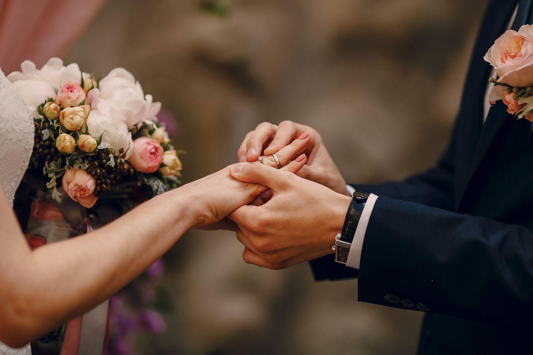 couple exchanging rings at wedding