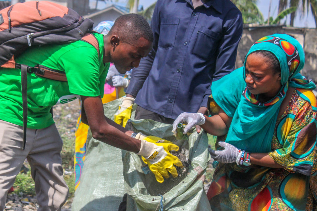 Olarip during a community cleanup in Kigamboni, Dar es Salaam.  Photo Credits: Khamis Hamad