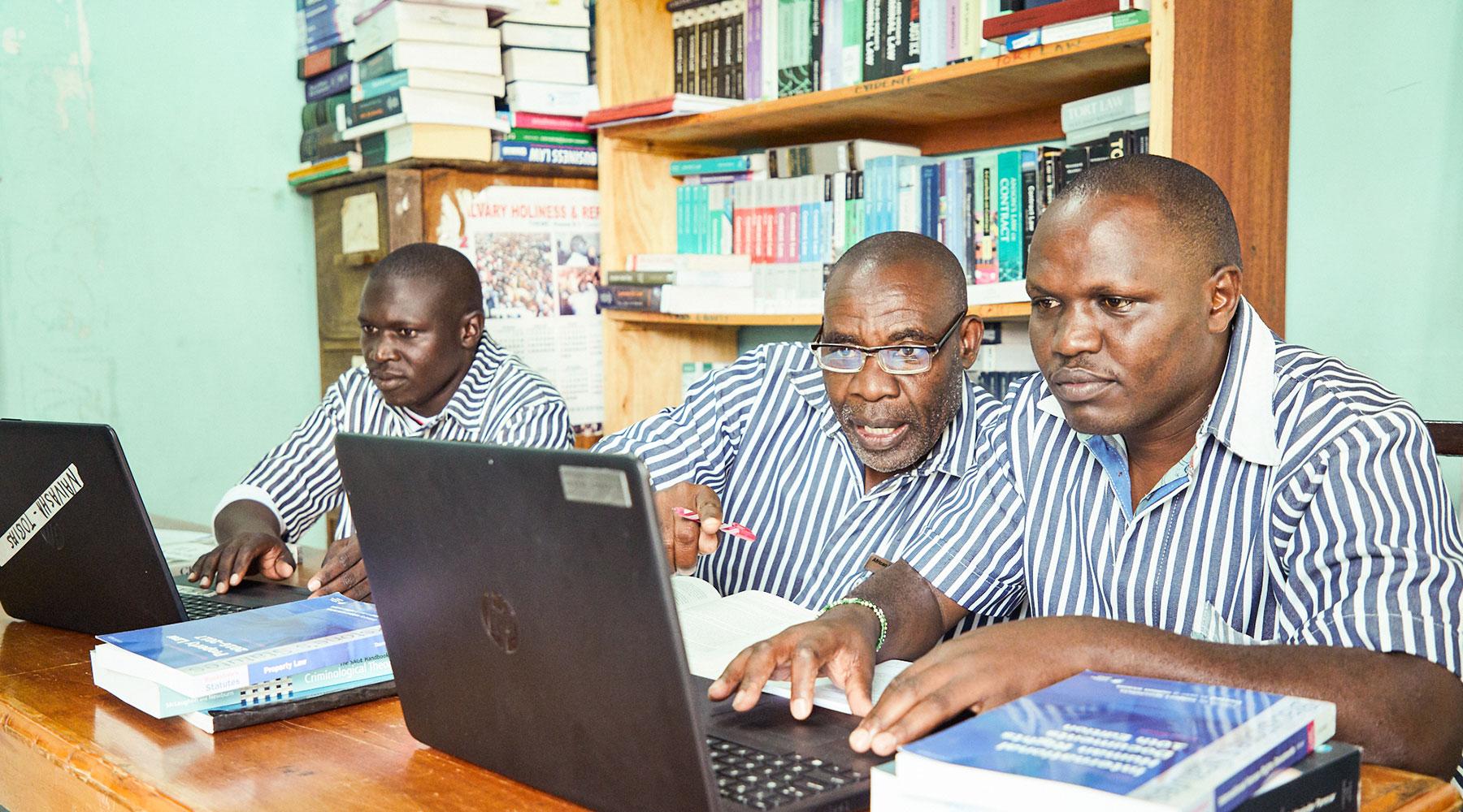 Peer educators and paralegals working a case at Naivasha Maximum Prison, Kenya.