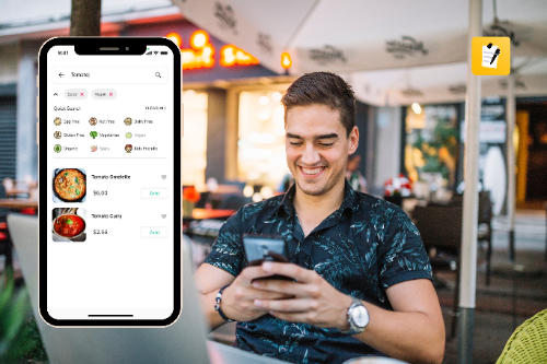 male customer looking at the digital menu of the restaurant for ordering food using his mobile phone