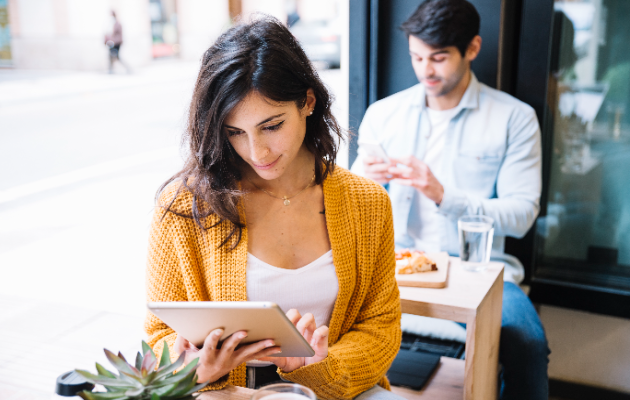 Female customer browsing restaurant menu from her tablet