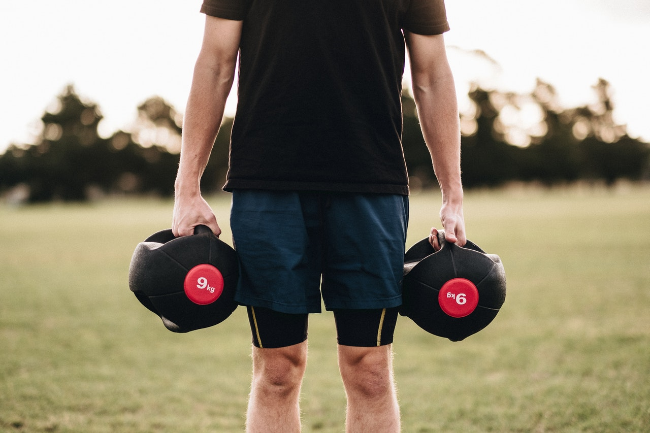 Guy Holding Two Dumbbells in His Hands
