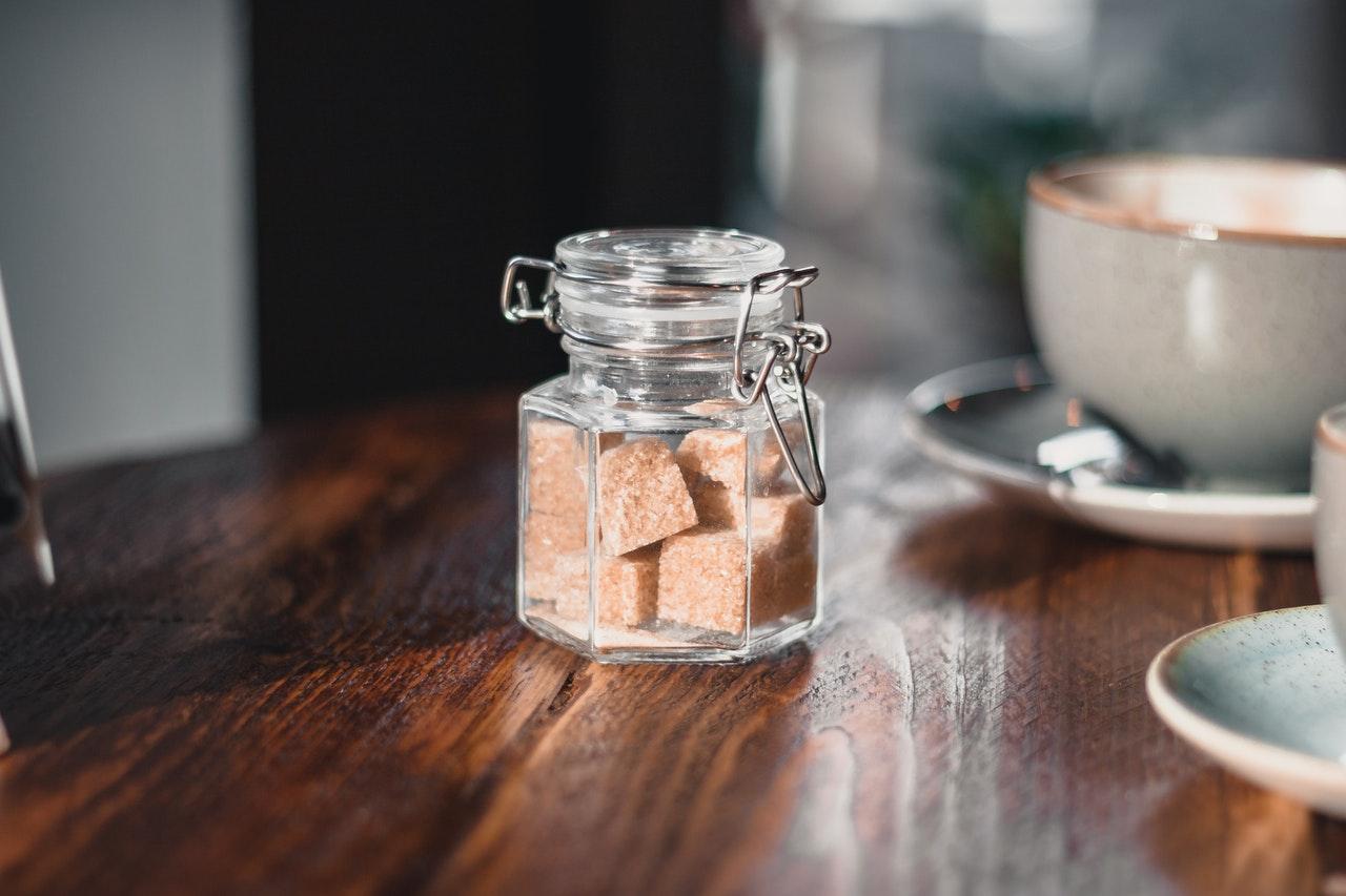 Sugar box with coffee mugs