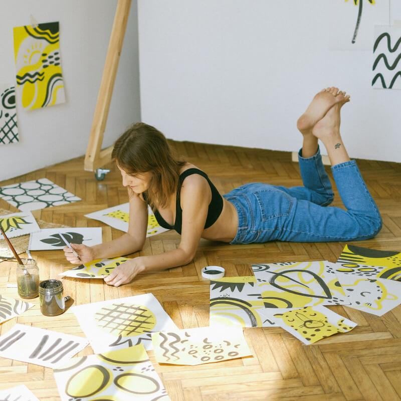 Artist working on the floor
