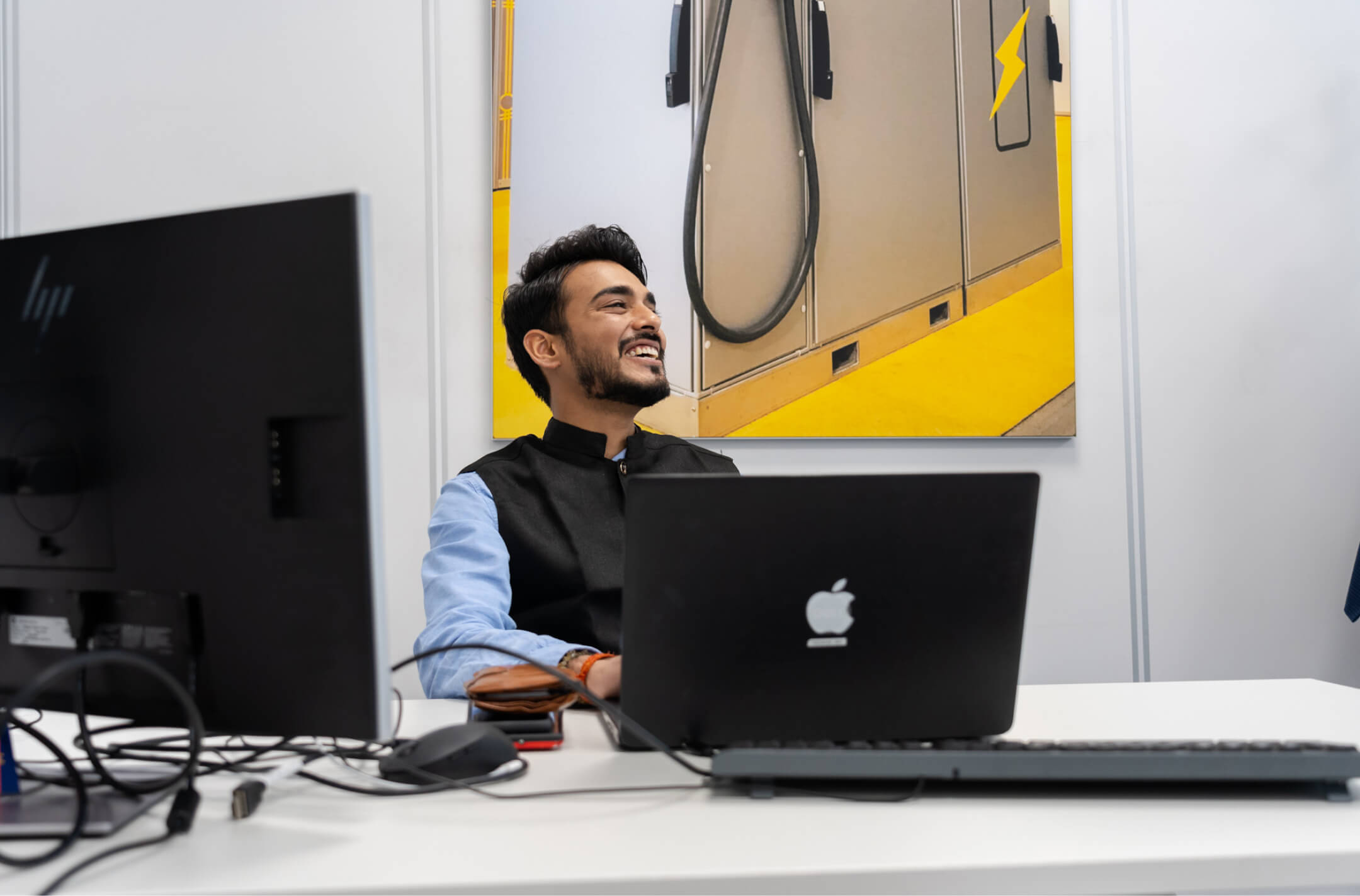 Man laughing at Heliox office