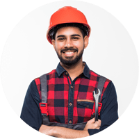 Man in a hardhat with a wrench