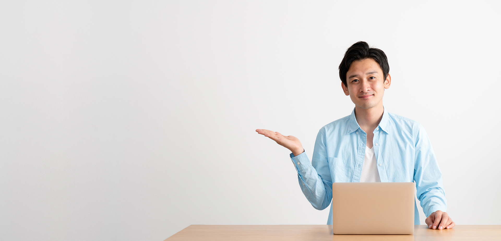 Person working on their laptop with their hand out