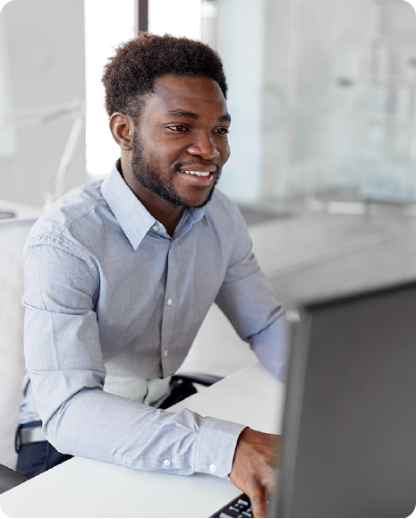 Young Black man works on a computer