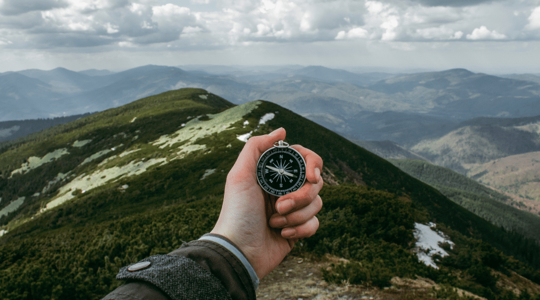 Picture of a hand holding a compass
