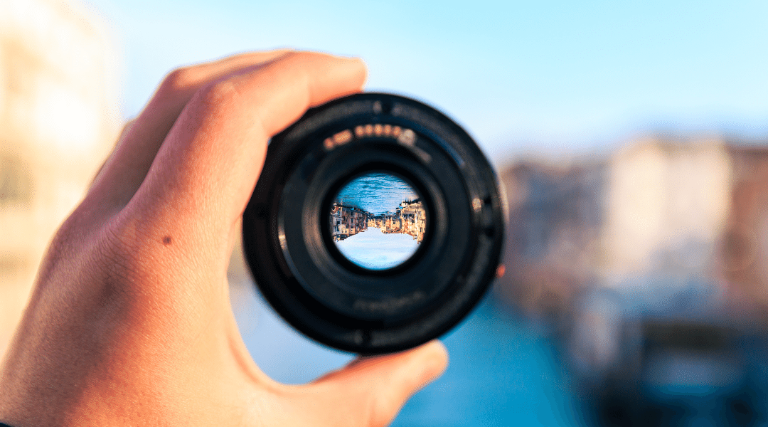 Picture of a person holding a camera lens