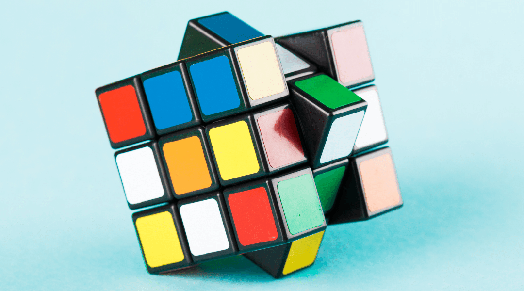 Rubik's cube on a light blue background