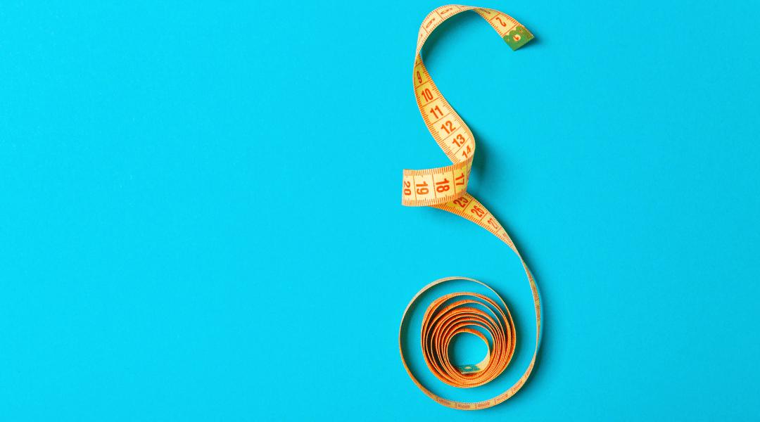 Tape measure on light bright blue background