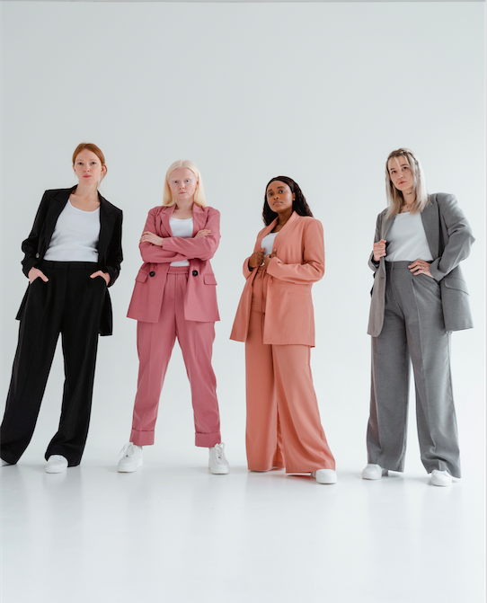 Group of women in pantsuits