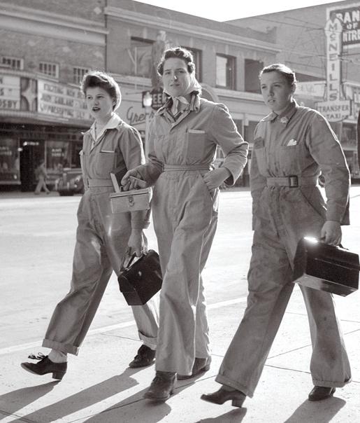 Three women heading to work during World War II