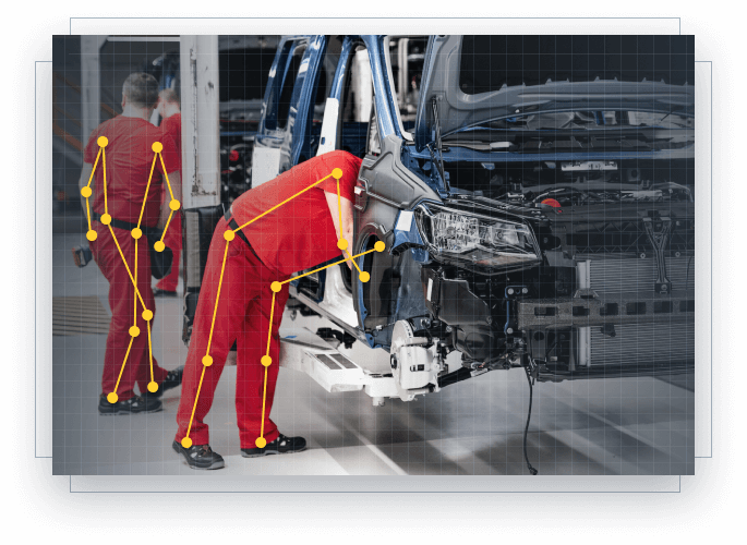 two persons working on a car assembly line
