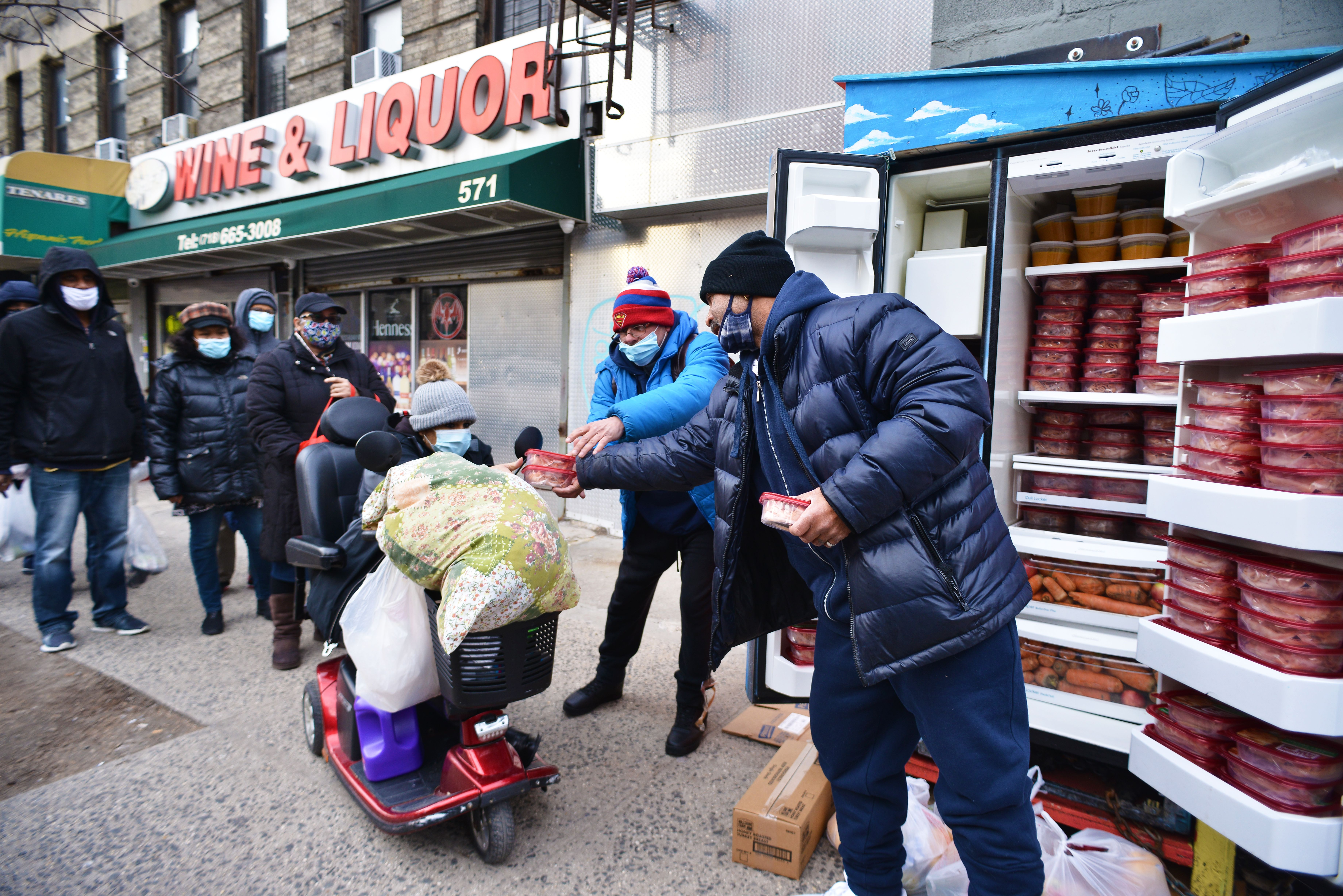 People delivering food to a fridge