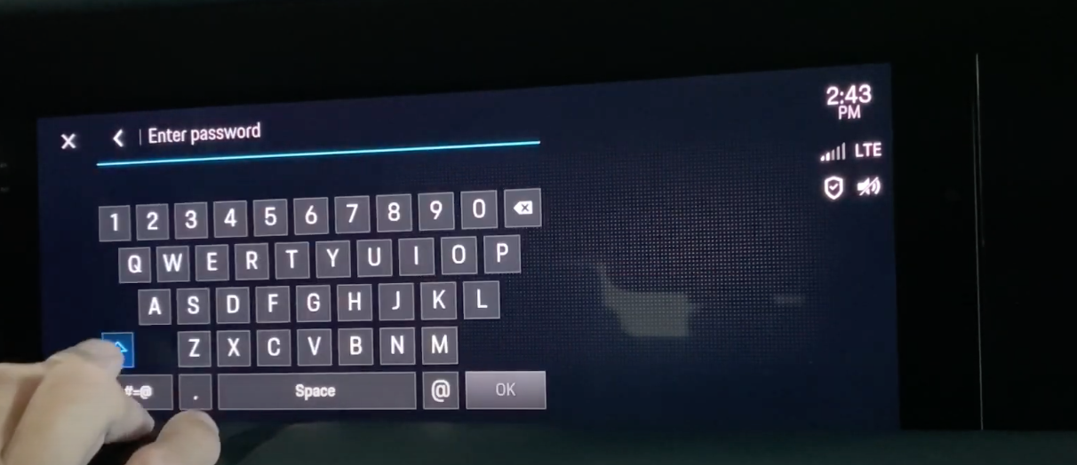 A screen with a keyboard and input for password