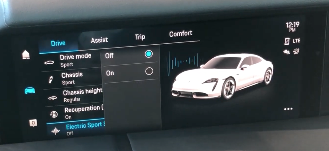 A screen with a radio button selector overlay, and a view of the car