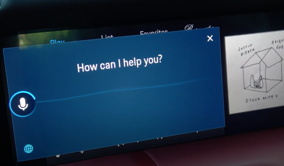 A screen showing the voice assistant processing audio with a microphone icon