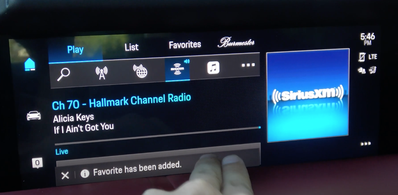 A screen with a notification indicating that a favorite radio station has been added