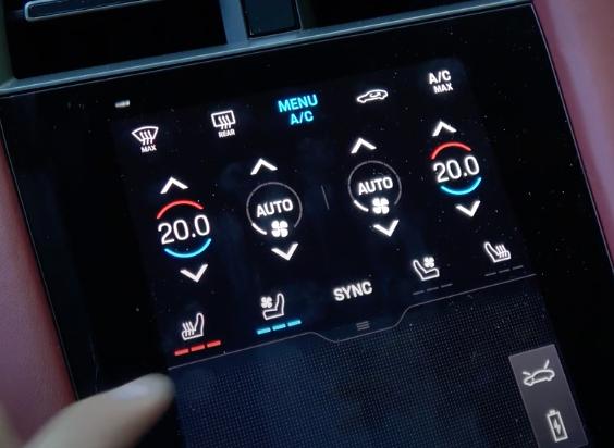 A user adjusting the seat temperature