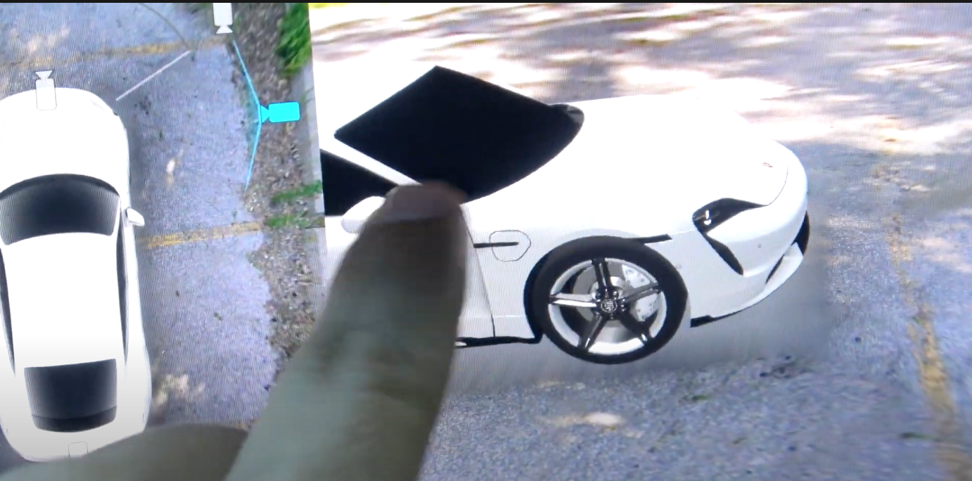 A 360 camera showing different angles of a car on the infotainment screen