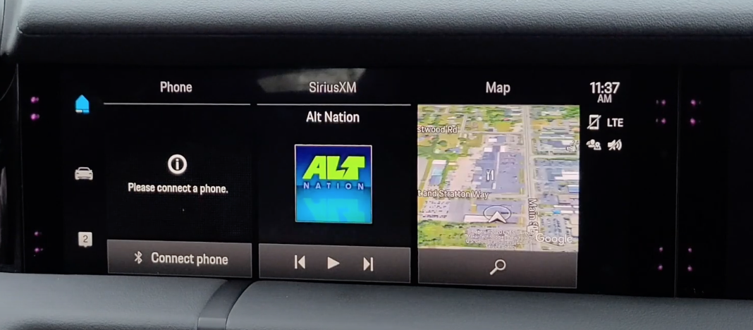 Home screen of an infotainment system with phone connectivity, radio and navigation