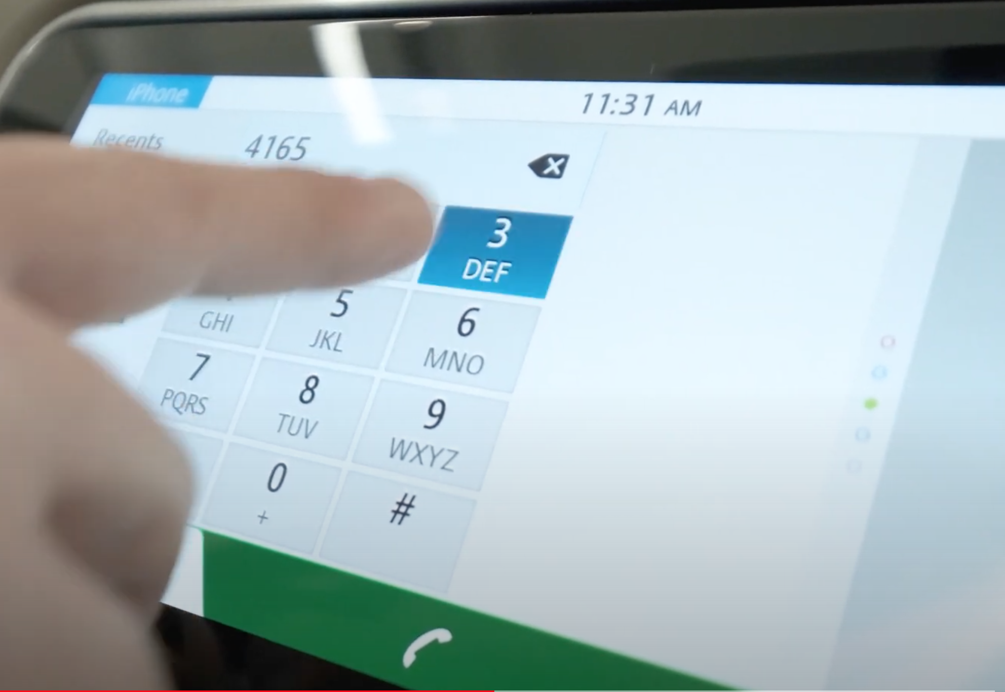 A user entering a phone number on a keypad