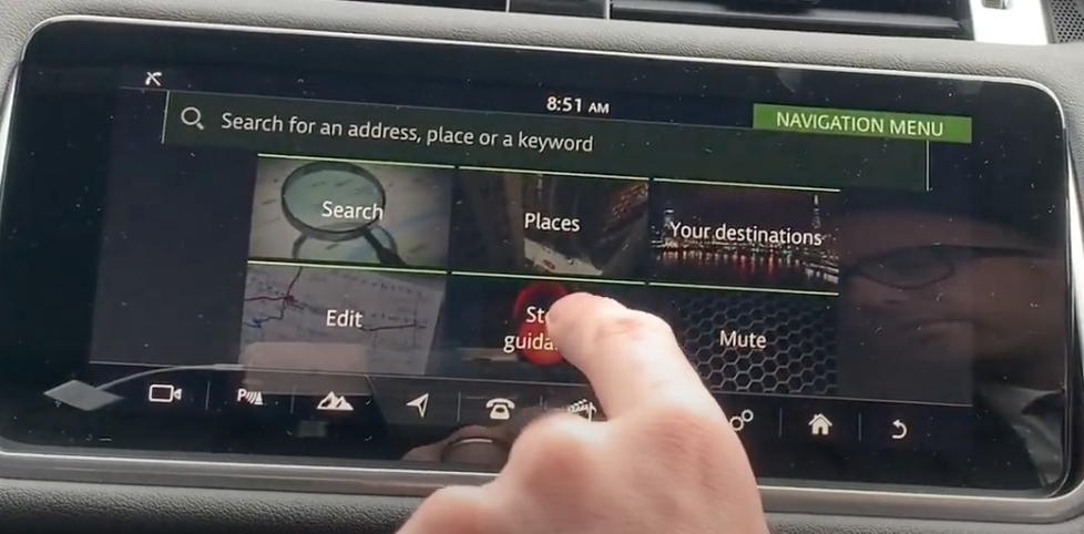 User pressing on a button to stop route guidance