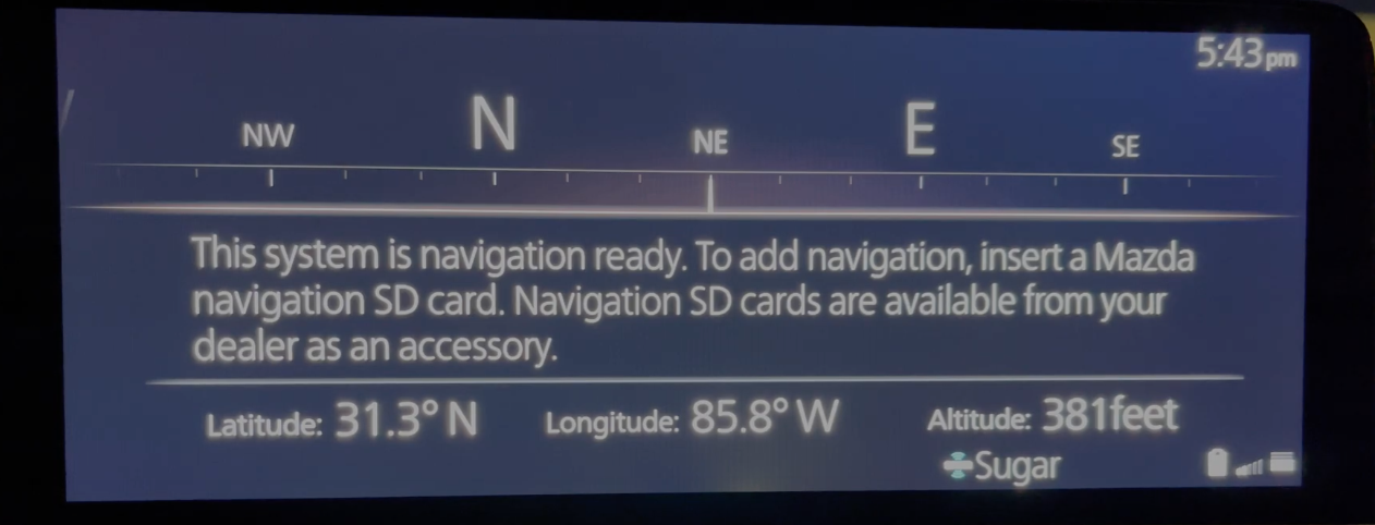 Informing the user that a navigation SD card is required to use the vehicle's navigation