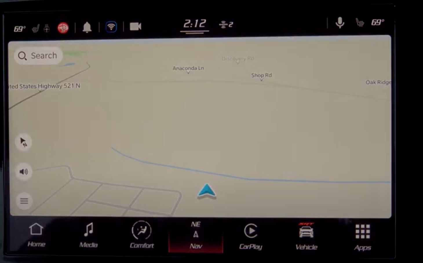 A view of the map in the navigation system of the infotainment display with a blue arrow indicating where a user is