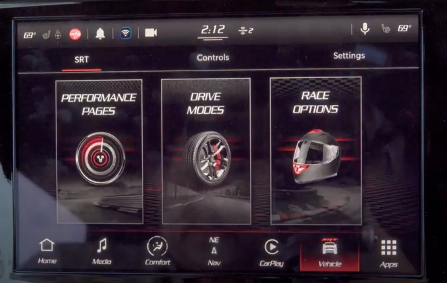 Vehicle information screen with three options to see, performance pages, drive modes and race options