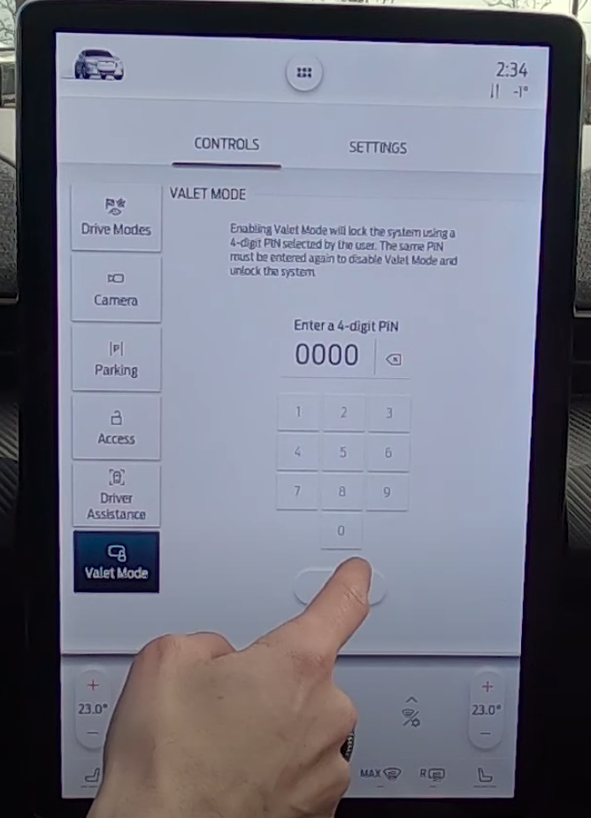 A user entering a passcode onto the keypad to set up valet mode