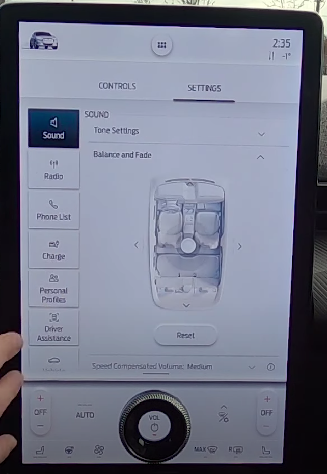 Audio settings page with an illustration of a car where a user can adjust the balance and fade