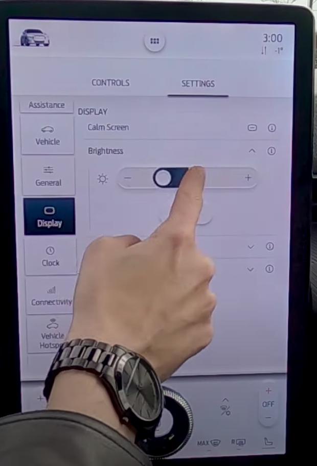 A user adjusting the brightness settings through sliding their finger