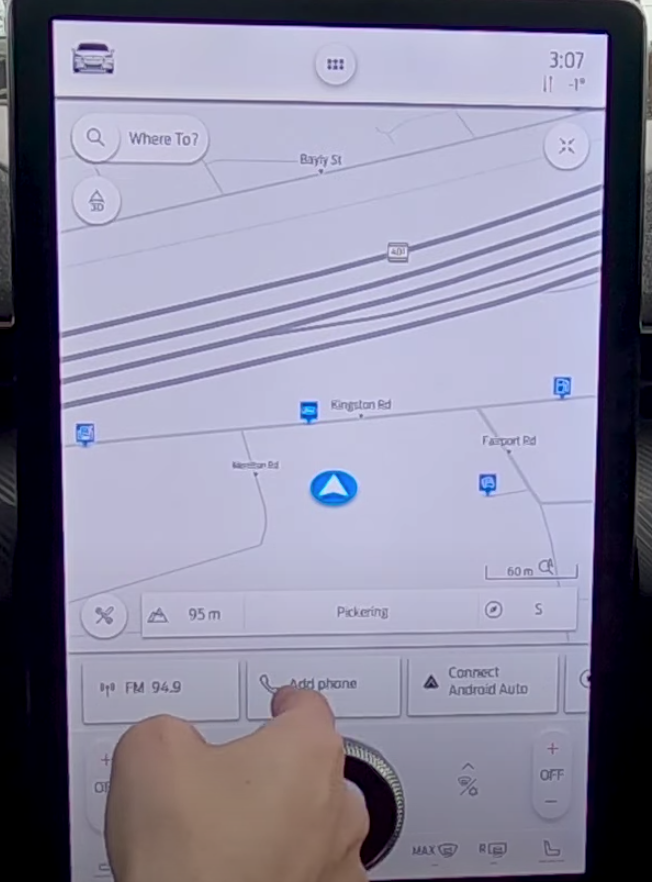 Map view of the navigation app that is within the infotainment system with an arrow indicating the current location of a user