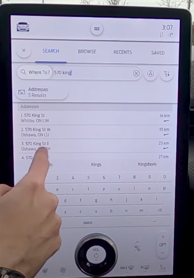 A user selecting an adress from a list of locations to navigate to