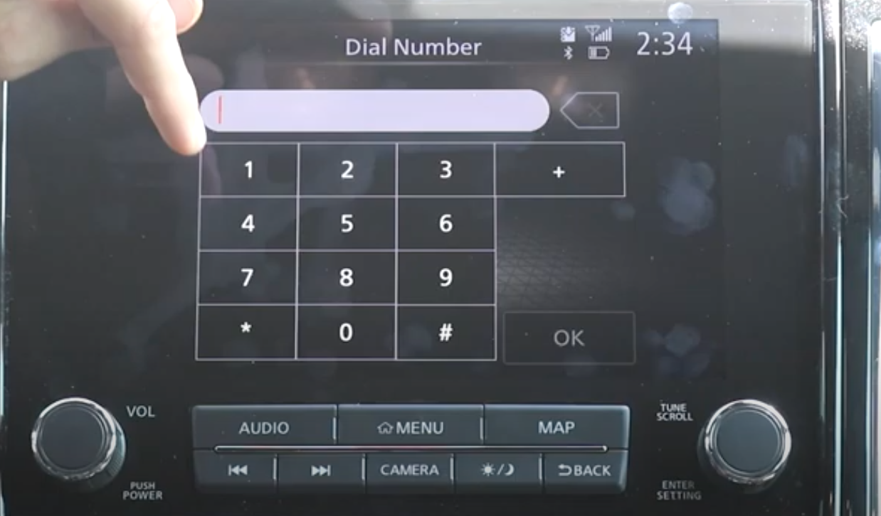 Dial pad to make a call through the vehicle