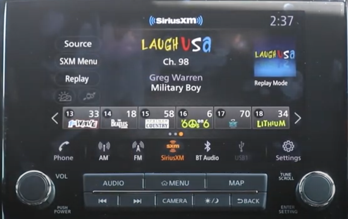 The music player playing a comedy channel with presets underneath