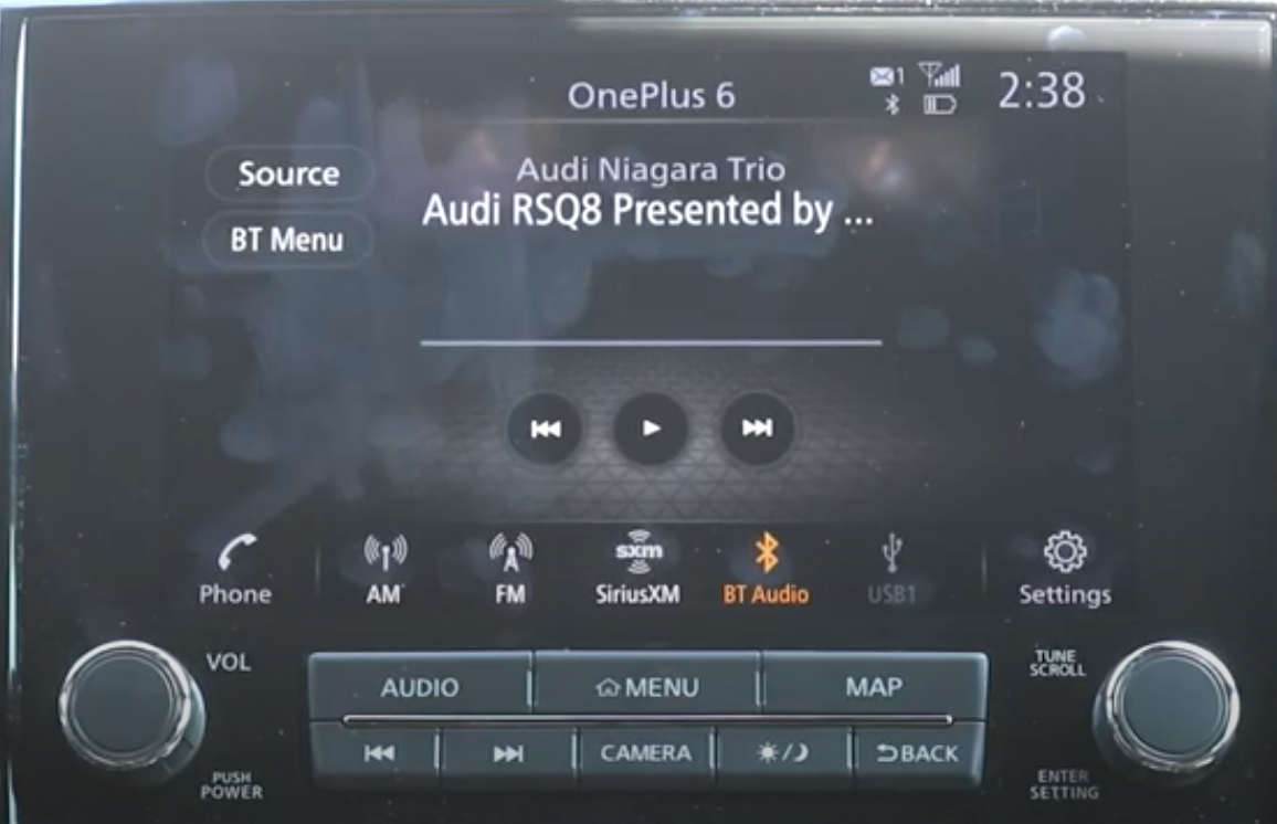 Player screen playing from a selected audio source with the others listed at the bottom