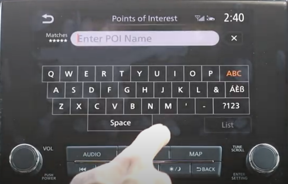 Digital keyboard to enter a point of interest within the navigation system