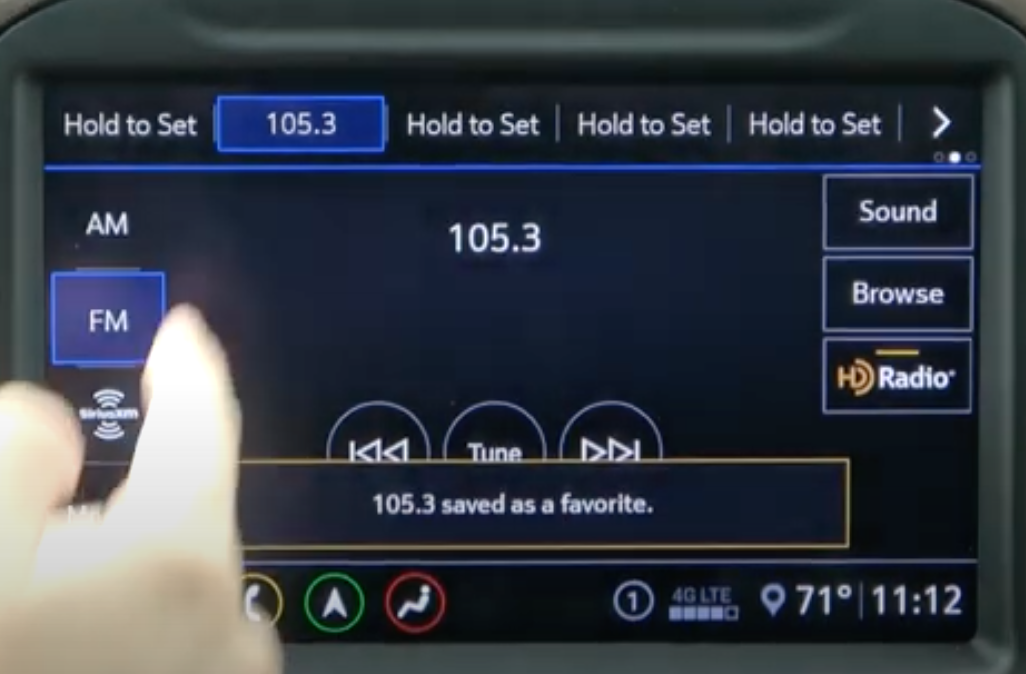 Setting a radio preset by long tapping the preset row on the top of the music player